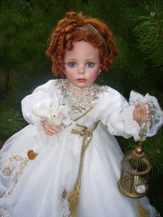 Фарфоровые куклы и статуэтки