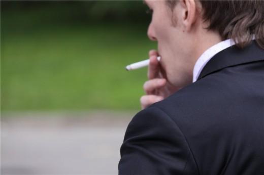 От курения болит... поясница