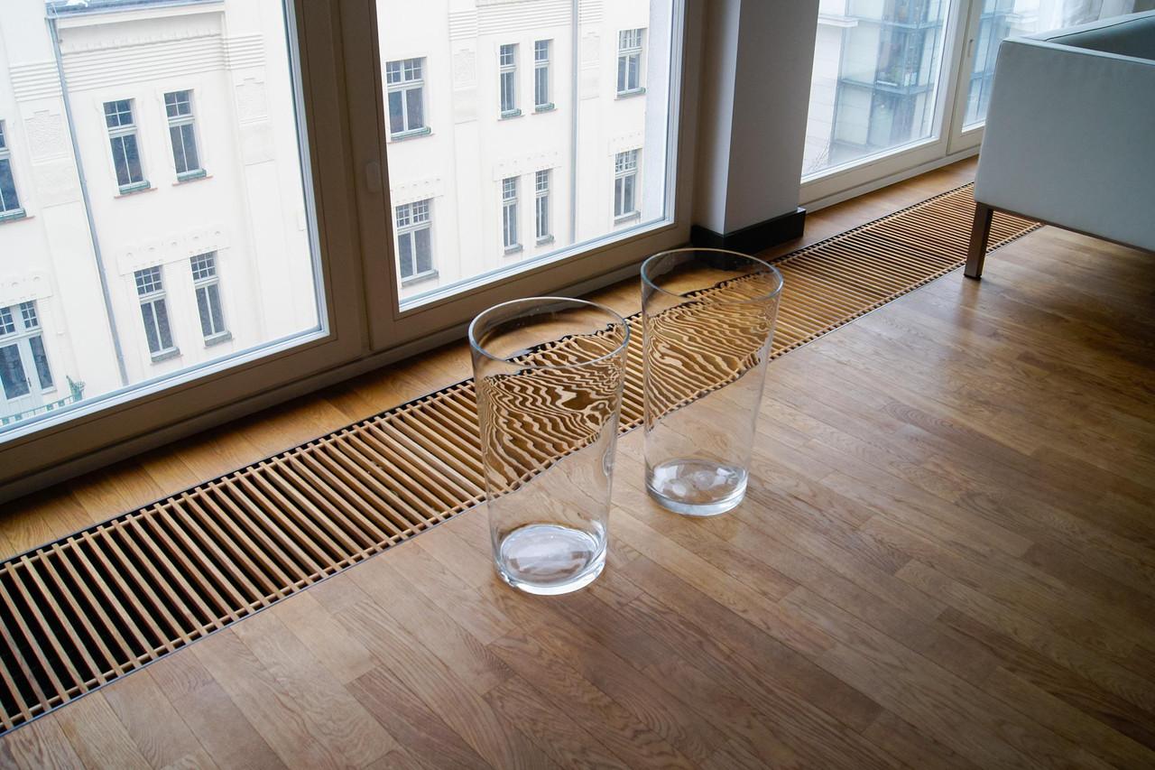 Скрытый в полу радиатор - внутрипольное отопление на кухне